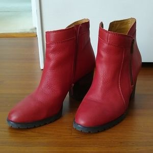 Red faux-leather ankle boots